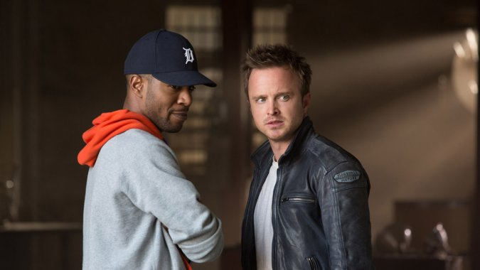 "Kid Cudi y Aaron Paul en ""Need for Speed"" (2014)."